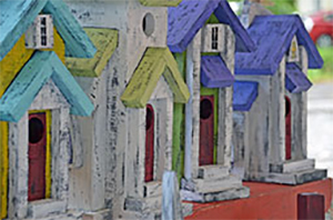 row of colorful birdhouses
